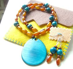 Blue and Gold Tagua Nut Slice Necklace and by mcclouddesigns, $25.00