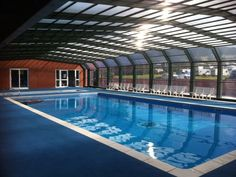 covered outdoor heated swimming pool - dorset,