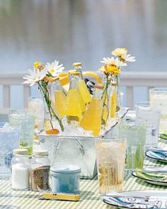 Fill a metal planter with ice and flowers to turn it into a bright beverage cooler.