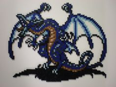 Final Fantasy IV Bahamut dragon perler bead sprite by on deviantART Pokemon Perler Beads, 3d Perler Bead, Hama Beads, Beaded Cross Stitch, Cross Stitch Patterns, Geek Perler, Christmas Perler Beads, Final Fantasy Iv, Nerd Crafts