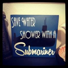 Save Water shower with a Submariner wood and vinyl sign. I totally want this for my bathroom!!!