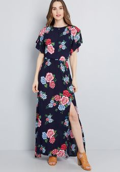 Gazebo Goddess Maxi Dress - As ethereal as the cherry blossoms blooming around you, this navy blue maxi dress embodies your grace and grandeur. Made of an airy, woven fabric, and finessed with red, pink, and sky blue flowers, dramatic flutter sleeves, and an off-centered vent on its skirt, this frock is a divine example of your beguiling style.