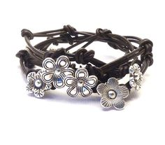 Knotted Leather Wrap Bracelet with Flower Charms,yoga jewelry,wrapped, wrapping, wrap around,wrist wrap. $40.00, via Etsy.