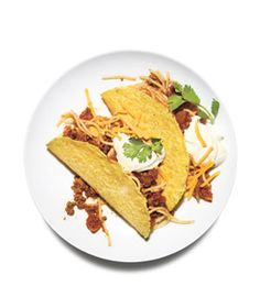 Spaghetti tacos.... interesting! Kids would love this. Taco flavoured spaghetti (chili powder) and topped with cheddar, sour cream, and cilantro!