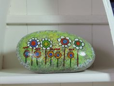 Inspirational hand painted beach stone in bright primary colors enhanced with seed beads on doodle art. via Etsy
