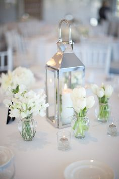 simple white and silver wedding centerpiece / http://www.himisspuff.com/white-tulip-wedding-ideas-for-spring-weddings/9/