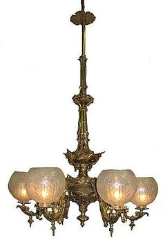 One of over a dozen gasolier chandeliers that will be sold (at least one made by Cornelius & Baker).