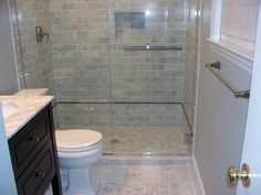 bathrooms with subway tile photos | ... Subway Tile Wall Panel In Clear Glass Sliding Door Small Bathroom
