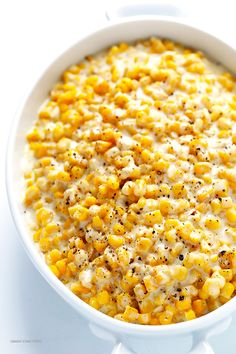 Slow Cooker Creamed Corn Recipe -- all you need are a few easy ingredients to make the most delicious corn in the crock pot! | gimmesomeoven.com #thanksgiving
