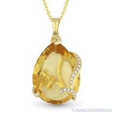 The featured pendant showcases a pear-shape citrine held by a fancy setting crafted in 14k yellow gold & adorned with round cut diamond accents along the swirling design.