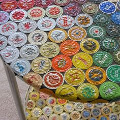 upcycled bottlecap table.  pretty cool. :) would be amazing in the basement