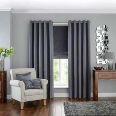 These ready made curtains from Hotel are finished in a shade of graphite grey and feature an eyelet header for a…