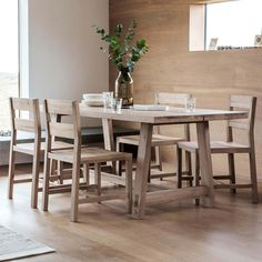 Narrative Solid Oak Plank Dining Set Crafted from solid oak with beautiful exposed joints and a mellow natural finish. the Narrative range has true design integrity and an inherent solidity that ensures it will stand the test of time. The substantial Narrative plank table makes the meal the main event. No distractions, no fuss, just beautiful quality. Large enough for entertaining, family meals and a relaxed breakfast with plenty of room for the papers. Available in two sizes