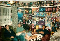 90s ravers. everyone's room was like this, covered in flyers. points if you had been to them all.