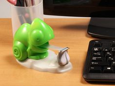 You won't blend in with this color-changing chameleon refillable tape dispenser. Its fun chameleon design changes color when touched.