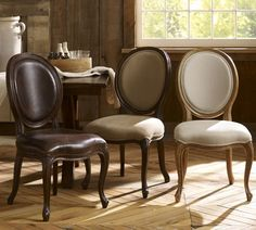 The Louis Dining Chair- Not modern or industrial, but adds some diversity to a space that is. I love this chair. The frame is hand-carved of a solid piece of wood. Available with leather, linen, or everyday suede upholstery.
