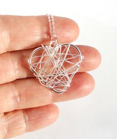 Gleaming silver heart and sterling chain.TRENDING by EvasJewellery