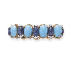 A TURQUOISE, SAPPHIRE AND DIAMOND BRACELET, BY DAVID WEBB  Of flexible design, composed of a series of cabochon turquoise, each within a gold beadwork surround, alternately-set with cabochon sapphires, each enhanced by circular-cut diamond trim, mounted in platinum and 18k gold, circa 1965,