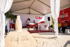 "Coca-Cola sponsored a ""Coke Cabana"" at the Grand Tasting as well as bars inside the north end tent in a promotion for the brand's 100th anniversary. Decor included a sand sculpture.  Photo: Elizabeth Renfrow for BizBash"