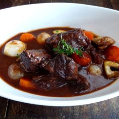 Beef Bourguignon - some modifications to this recipe - I didn't have cognac, so used red wine to deglaze the pan; the carrots used in cooking the beef were good, so I didn't cook any separately; my beef only took 2 hours to cook & the sauce was sufficiently reduced in the oven so I didn't boil it down or add sugar.  Serve with mashed potatoes :)