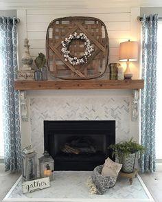 Remodeled fireplace. Shiplap, wood mantle, herringbone tile, farmhouse, Corbels.