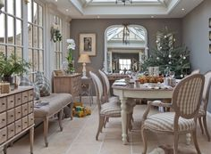 Conservatory from Vale Garden Houses - Grey, beige & white dining room with check/gingham fabric on the chairs