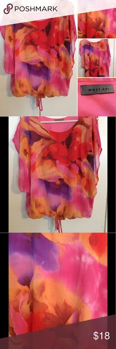 West Kei floral top This beautiful West Kei floral top is one n excellent new like condition. It's has a gorgeous pattern to it in pinks,purples, and oranges. It's a size medium. It has a pink built in tank top with a sheer floral outer lining. Comes from a smoke free home West Kei Tops