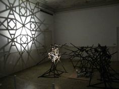 Intersection by Rashad Alakbarov at Venice Biennale 2013 uses flashing spotlights to cast patterned shadows on the wall.