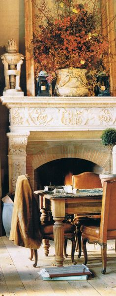 Beautiful eclectic inspiration room with wonderful fireplace - note: the leather chairs with hand set nail head detail.