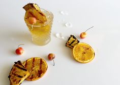 """These 5 Grilled Cocktails Will Make Your Summer I """"Summertime's signature drinks are all built around the freshest, juiciest fruits of the season. Think of everything from pineapple mai tais to citrusy lemonade. Now, take that fruit and grill it, and you're rocking a whole new level of intensified flavor from the smoky, caramelized juices."""""""