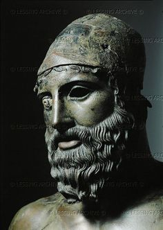 HELLENISTIC SCULPTURE 5TH BCE Phidias,sculptor Head of bronze statue of a young man with helmet: Detail of 10-01-05/21 etc. Statue found in 1972 in the Bay of Riace, Calabria, Italy. Greek original possibly by Phidias (460 BCE), probably a votive statue from a sanctuary at Delphi, shipwrecked on the Italian coast. Museo Nazionale, Reggio Calabria, Italy