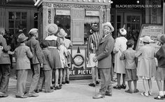 African American children in front of movie theater on Easter Sunday, Chicago, 1941.  NOW PLAYING: James (Jimmy) Stewart, Katherine Hepburn and Cary Grant in the Philadelphia Story, released in 1940. Admission - Adults 44 cents, Children 10 cents