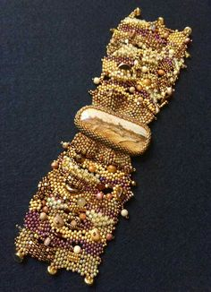 Freeform peyote cuff by Marlene Oman Emmons on FB.  Seed beads, pearls, glass beads, scenic picture jasper cabochon.