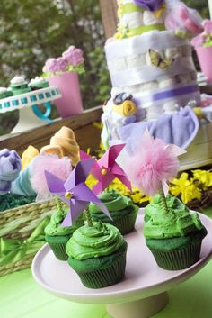 Pinwheel cupcakes at a garden baby shower party! See more party planning ideas at CatchMyParty.com!