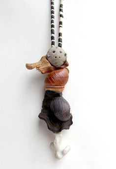 Han Dong  Pendant: Who am I Series of Works 2011  Ancient jade mask, wood, conch, corallite, 5 x 14 x 3.5 cm