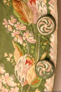 Detail of buttons, 3-piece formal suit, France or England, c. 1790-1800. Green silk taffetawit decorativ floral embroidery, white silk satin lining.