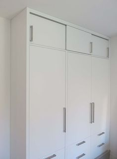 Fitted wardrobe, birch ply carcasses and drawers with sprayed MDF fronts Tall Cabinet Storage, Locker Storage, Fitted Wardrobes, Birch Ply, Lockers, Drawers, Furniture Design, Divider, Room