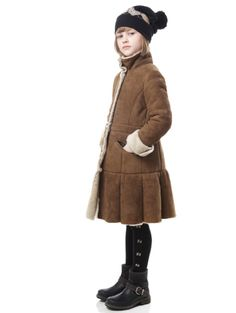 Fendi fall/winter 2013 shearling coat with frilled hem for girlswear from this Italian designer label.