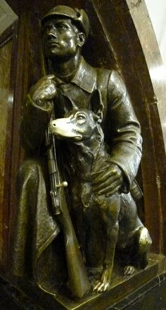 """Man-and-dog"", Revolution Square metro station, Moscow, Russia. There is a superstition that it is good luck to touch the dog's nose."