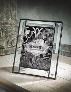 This beveled glass frame would look great in any man's office or man cave. Throw in a picture of his last hunting or fishing trip and you have the perfect Father's Day gift or den decor!