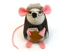 This little Lawyer Mouse knows the law and works to uphold it in court. He is so cute that he wins all his cases! He comes complete with traditional grey wig and robes, and he carries an attache case with some evidence sticking out of it. He is the p lawyers attorneys legal