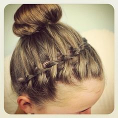 Tired of using a boring old headband? Try a waterfall braid across the top of your head, then secure the look into a top knot for a summer h...