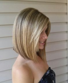 Long angled bob haircut with side bangs and highlights.... well my hair has natural highlights so i need to just get it cut :P