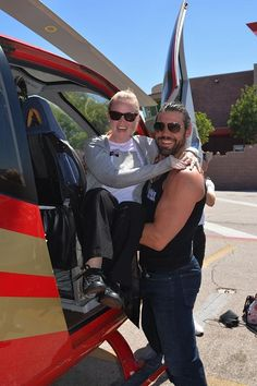 """Alex Biffin from """"Thunder From Down Under"""" lifts Briana O'Donnell into the helicopter"""
