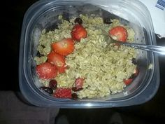 Old fashioned oatmeal topped with sliced strawberries and craisins. Drizzled honey on top.