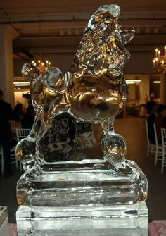 I am not sure if this is a ice sculpture or glass
