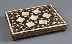 Double-Sided Game Board of chess and an unknown game. 16th century. France. Ivory, ebony. 3/4 x 14 1/2 x 11 1/2 inches (1.9 x 36.8 x 29.2 cm) Stand: 2 3/16 x 14 7/8 x 11 7/8 inches (5.6 x 37.8 x 30.2 cm)