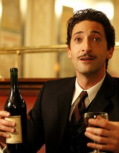 Adrien Brody (Midnight in Paris) as Dali - a relaxing looking bar place and cool dude