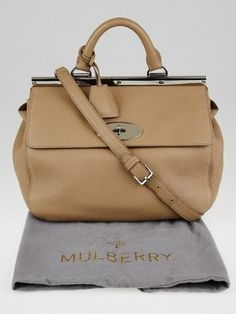 Founded in 1971, this luxury British label is known for their finely crafted leather goods. From the Fall/Winter 2013 collection comes the Suffolk bag. Composed of classic calf leather in timeless nude, this chic yet casual bag is secured with the iconic Mulberry Tree logo embossed turn-lock. The metal frame top is vintage-inspired. A rolled leather top handle and detachable long strap make this bag versatile. This bag will become an instant favorite in your collection! Retail price is $...