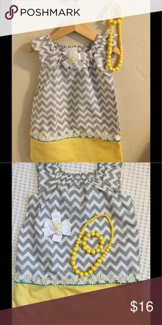 Little girls dress with matching jewelry and bow Summer ready with this cute ensemble. NWT I bought the dress and embellished it with the sweet daisy trim. I also made the bow. Comes with the matching jewelry set and hair bow. 100% cotton. I have 3 available sizes 2T, 4T and 5T. Dresses Casual